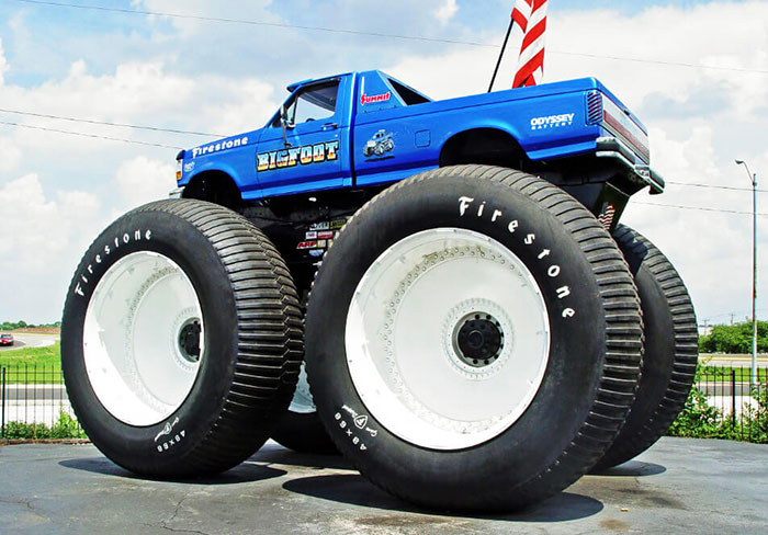 biggest monster truck in the world is rolling over cars. Black Bedroom Furniture Sets. Home Design Ideas